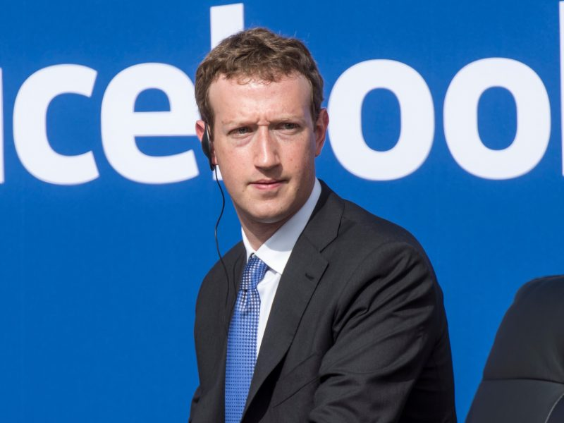 """Mark Zuckerberg, chief executive officer of Facebook Inc., listens as Narendra Modi, India's prime minister, not pictured, speaks during a town hall meeting at Facebook headquarters in Menlo Park, California, U.S., on Sunday, Sept. 27, 2015. Prime Minister Modi plans on connecting 600,000 villages across India using fiber optic cable as part of his """"dream"""" to expand the world's largest democracy's economy to $20 trillion. Photographer: David Paul Morris/Bloomberg *** Local Caption *** Mark Zuckerberg"""